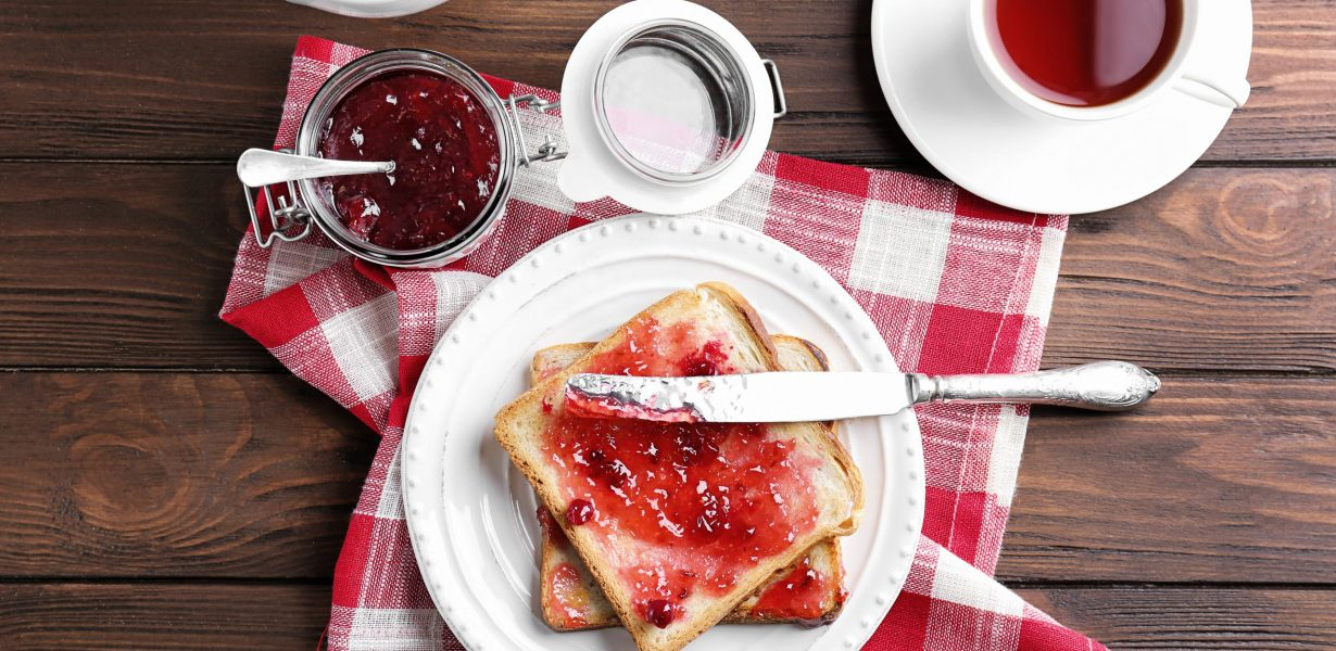 Delicious toasts with sweet jam on plate