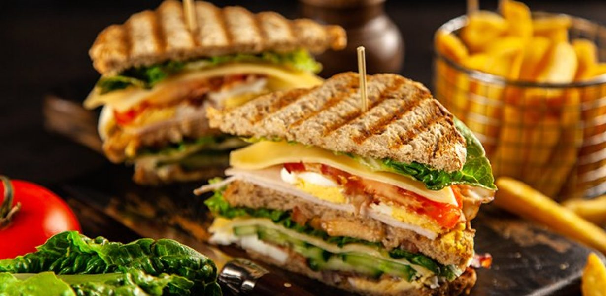 Tall club sandwich and french fries